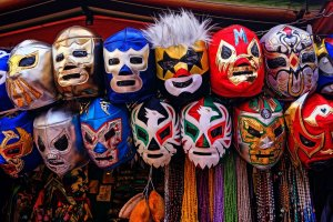 assorted-color of masks hanged on rod