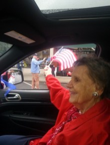Dee Sorenson proudly waves her flag to onlookers