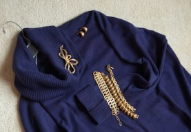 purple sweater with jewelry