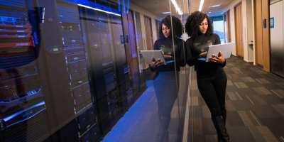 woman standing near a server
