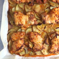 Roasted Harissa Chicken over Scalloped Potatoes