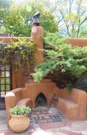 An outdoor kiva fireplace!
