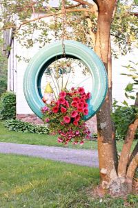 hanging tire planter - inspiration photo found on Pinterest