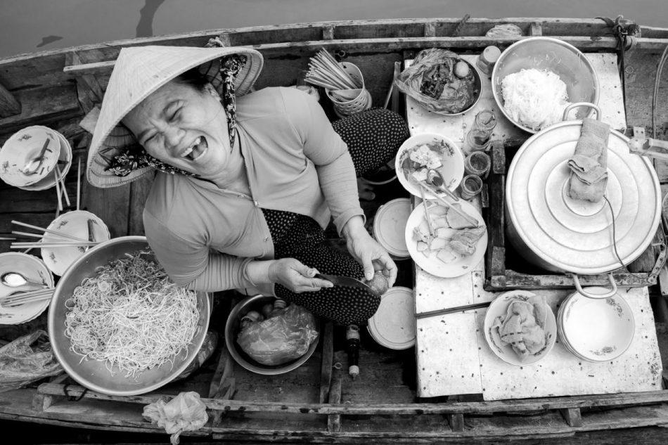 Laughing noodle vendor - Graeme Heckels