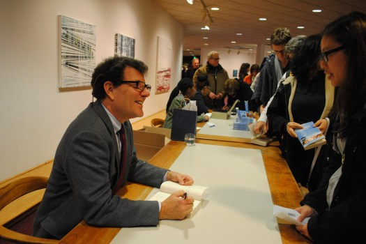 Nicholas Kristof signed copies of his book 'Half the Sky: Turning Oppression into Opportunity for Women Worldwide' after his speaking event at Goucher College on March 11. (Photo Courtesy of Rachel Brustein)