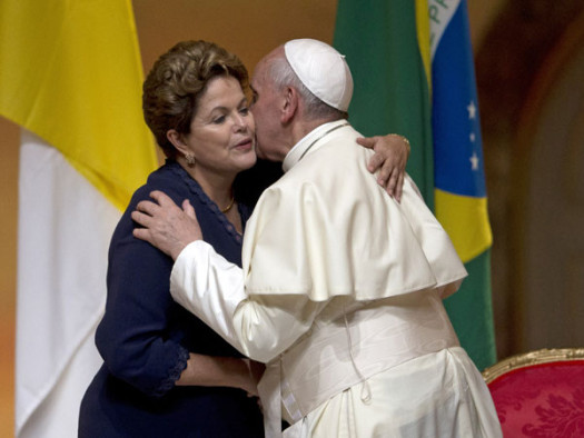 Pope Francis and Brazil's president Dilma Rouseff embrace during the opening ceremony of World Youth Day. (Google Images)