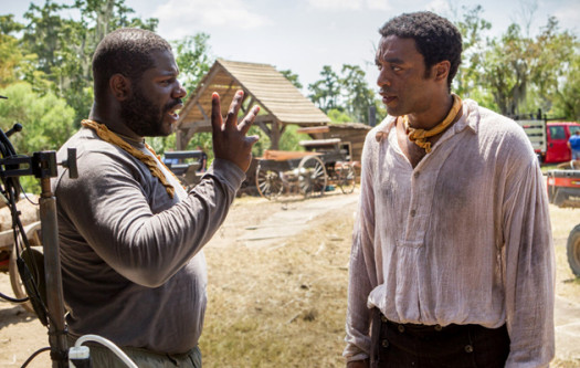 British director Steve McQueen directors British actor Chiwetel Ejiofor in the film '12 Years a Slave' winner of the 2014 Golden Globe award for Best Picture.  (Photo Credit: Google Images)