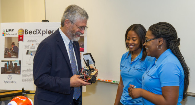 Dr. John P. Holdren meets with members of Spelman College's Spelbots team. Photo Credit: Spelman College