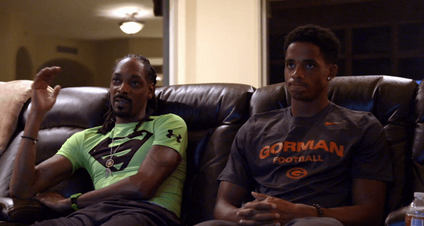 Snoop and his son watch tape of his game. (Photo Credit: ESPN)