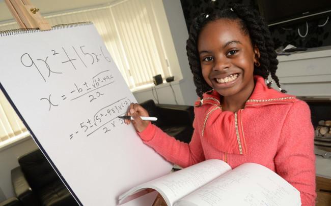 Math genius Esther Okade problem solves at home. (Photo: Google)