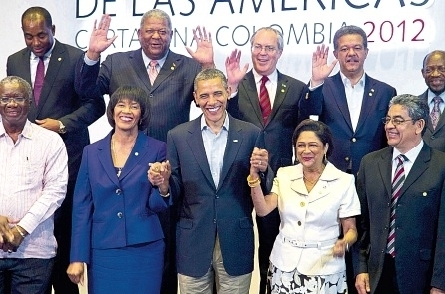 U.S. President Barack Obama is flanked by Caribbean leaders including Jamaican Prime Minister Portia Simpson Miller at the 2009 Summit of the Americas held in Port of Spain, Trinidad. (Photo: Google)