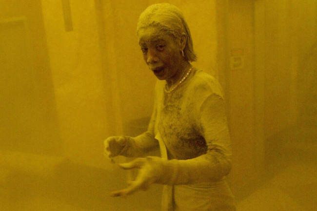 (FILES) This September 11, 2001 file photo shows Marcy Borders covered in dust as she takes refuge in an office building after one of the World Trade Center towers collapsed when commercial planes crashed into them in New York. US citizens were having breakfast before going to work when terrorists calmly boarded flights they will hijack and smash into New York, the Pentagon, and Shanksville, Pennsylvania, killing nearly 3,000. AFP PHOTO/Stan HONDA/FILES (Photo credit should read STAN HONDA/AFP/Getty Images)