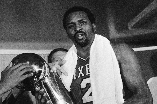 NBA legend Moses Malone holds the championship trophy for the 1983 NBA Finals. (Photo: Google Images)