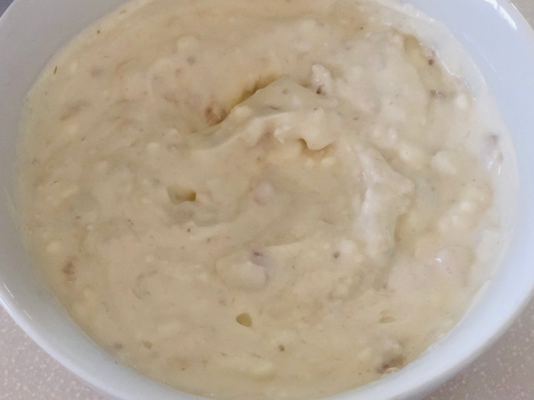 cream cheese and minced clams mixed together to make easy clam dip