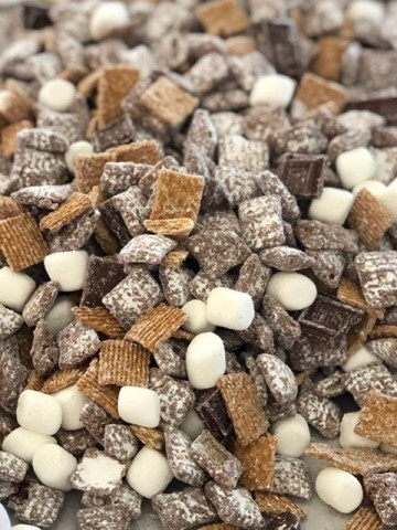 S'mores Muddy Buddies with chocolate, graham crackers and marshmallows to make the best snack mix