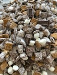 S'mores Muddy Buddies Snack Mix with milk chocolate, graham crackers and marshmallows