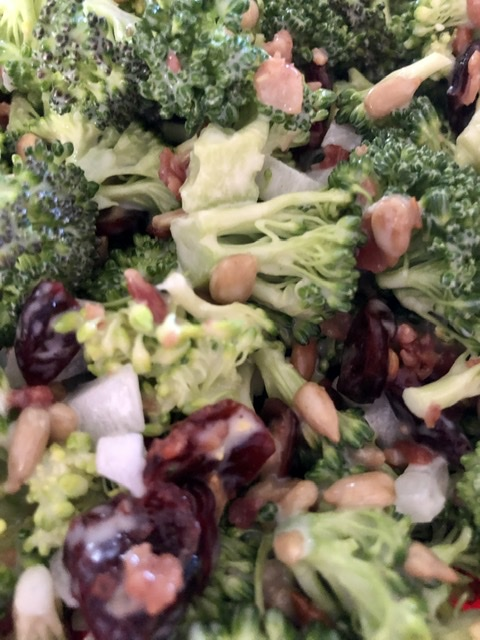 Easy Broccoli Salad with Bacon, onions, sunflower seeds, dried cranberries and a tangy sweet dressing