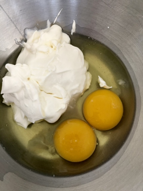 eggs, sour cream and vanilla for Easy Texas Sheet Cake