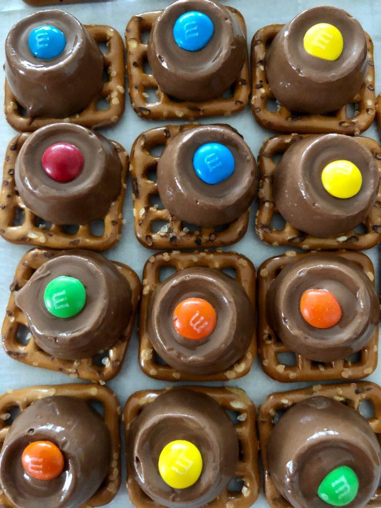 Rolo Pretzel Bites lined up on a pan
