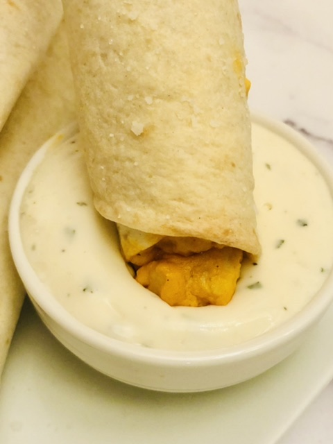 buffalo ranch taquito dipped in ranch dressing