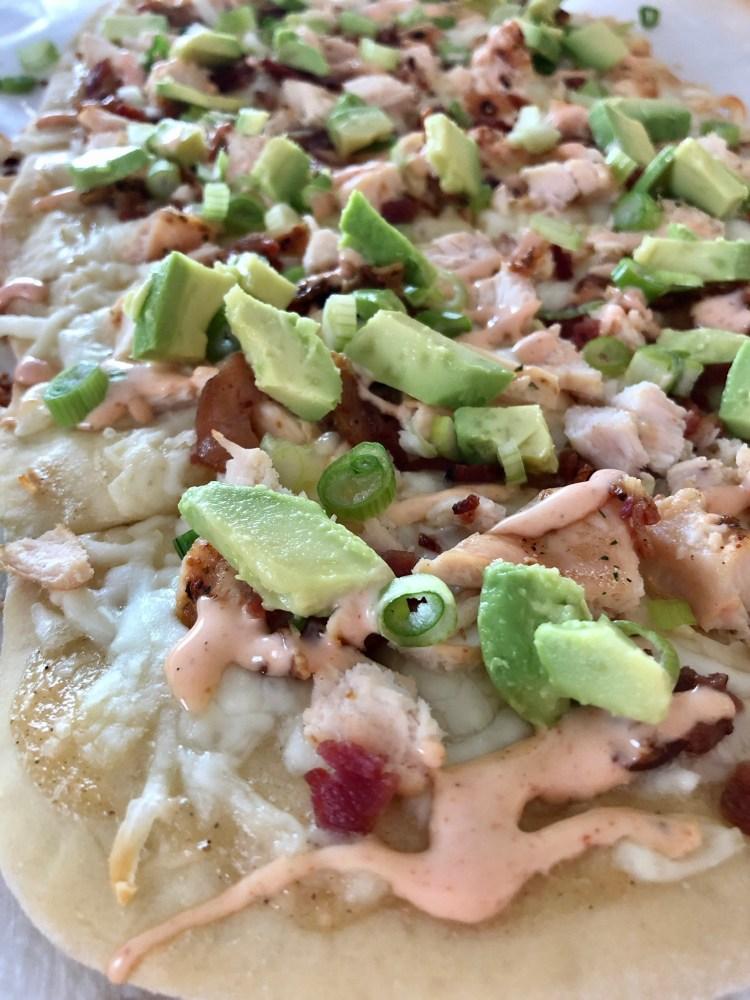 Chicken Bacon Avocado Flatbread close up shot