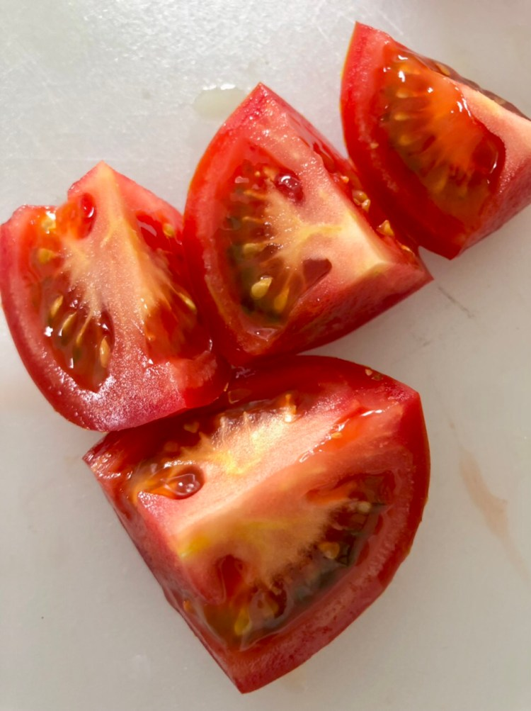 red tomatoes with the end removed and quartered into 4 pieces
