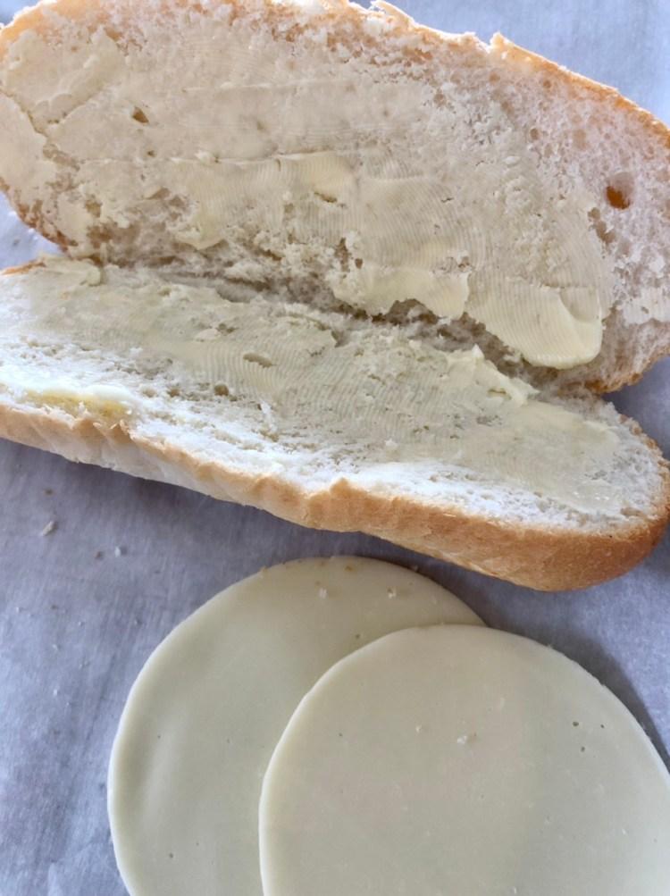 hoagie bun with butter spread on both halves