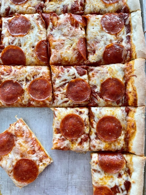 sheet pan pizza sliced for serving