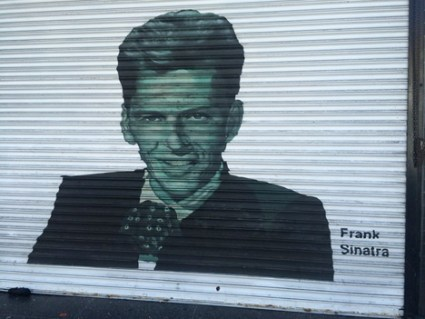 Frank Sinatra painted on a rolling door on Hollywood Boulevard.