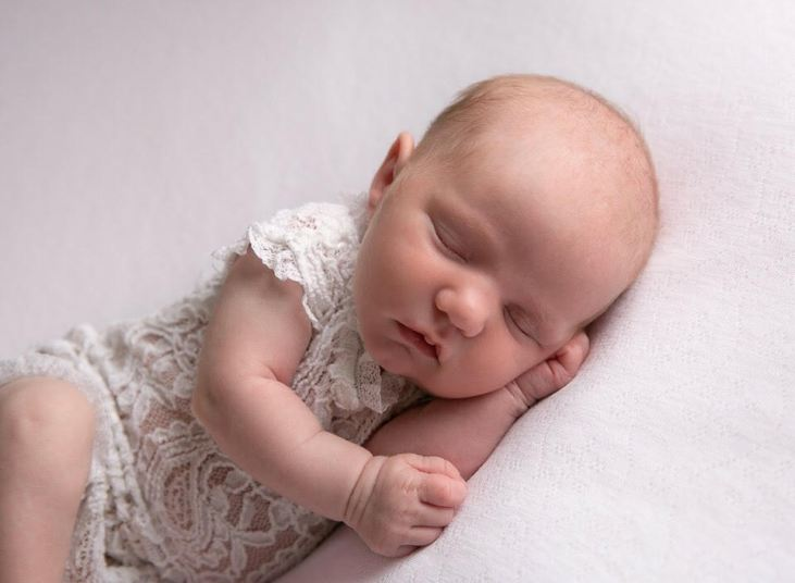 postnatal depression - newborn baby, white lace dress