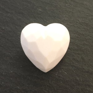 white heart shaped button