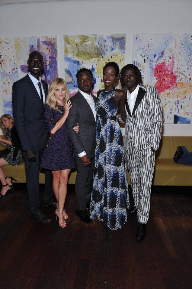 Ger Duany, Reese Witherspoon, Arnold Oceng, Kuoth Wiel and Emannuel Jal inside Nota Bene for the film party presented by Audi after the special presentation screening of The Good Lie during the Toronto International Film Festival.