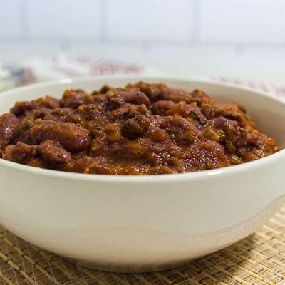chili presented in a white bowl, chili recipe