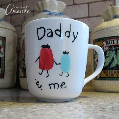 cup with finger prints saying daddy and me