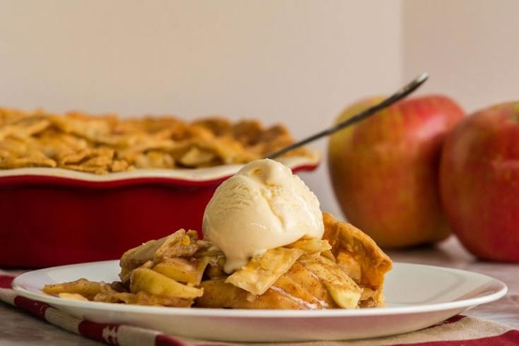 apple pie dished out with icecream on top