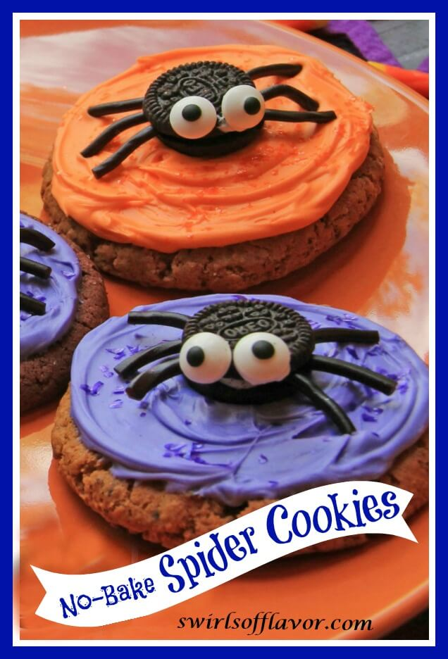 oatmeal style cookies with purple and orange icing.  An Oreo cookie in the middle on top with eyeballs and black sticks to make it look like a spider.
