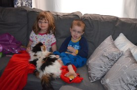 Molly keeping the kids company while they watch TV