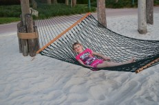 Abby relaxing on a hammock on the beach