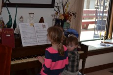 Abby and Macklan playing piano before Easter dinner at the Allison's
