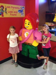 Ava and Abby in front of Lego Character