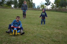 Aiden, riding down the hill being watched by Abby and Macklan.