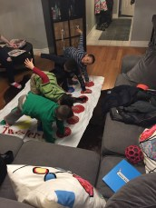 Aiden, Andre, Anthony and Jayden playing twister.
