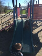 Marley going down the slide with Aiden at the secret park.
