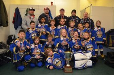 Abby and her team with the gold medal trophy from the playoffs.