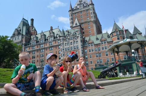 Colton, Aiden, Abby and Sage enjoying a ice cream cone in front of Chateau Frontenac
