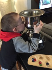 Aiden kissing the consolation cup.