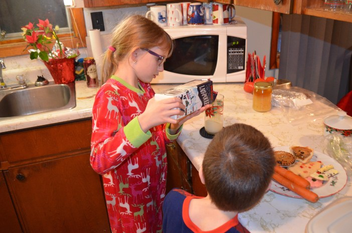 Abby & Aiden getting the Egg Nog, Cookies, and Carrots ready fro Santa and the reindeer.