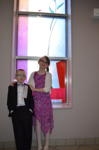 Aiden with big sister Abby after the ceremony