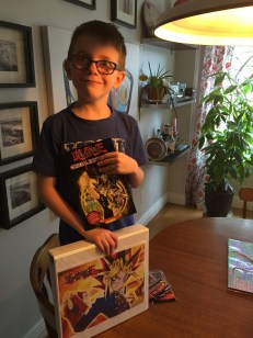 Aiden with his Yu-Gi-Oh binder
