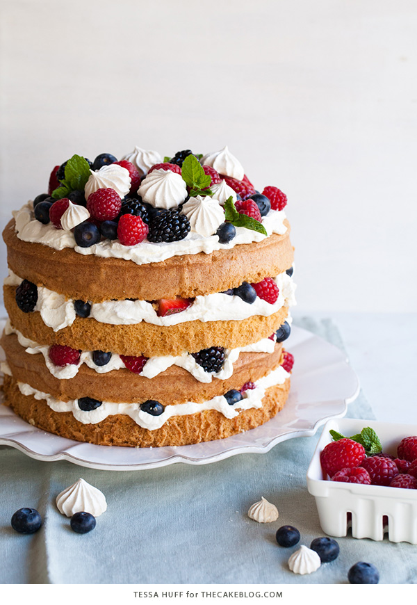 Mess Cake - Inspired by the classic dessert, this cake combines crisp meringues, sweetened cream, fresh berries - layered between an airy sponge cake.   By Tessa Huff for TheCakeBlog.com